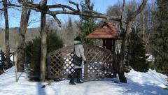 Woman dressed warm clothes snow open wood park gate pass winter Stock Footage