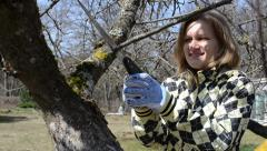 happy woman first spring garden works hobby tree cut prune - stock footage