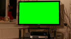 LED TV with green chroma key at Christmas at night - stock footage