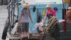 Cheung Chau fishing boat hosing down desk - Hong Kong Stock Footage