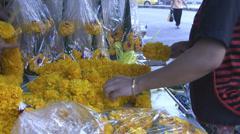 Threading Marigolds p305 Stock Footage