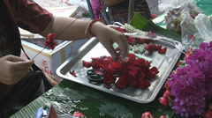 Threading Petals at the Flower Market p300 Stock Footage