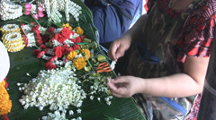 Making Garlands of Flowers p296 Stock Footage
