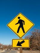 Pedestrian crossing vertical sign Stock Photos
