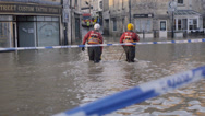 Stock Video Footage of Emergency workers wading through flood water, Bradford on Avon, UK