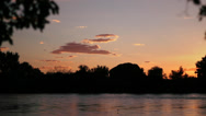 Stock Video Footage of View of Sunset from Riverbank