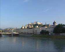 View across river Salzach at skyline Salzburg Old Town Stock Footage