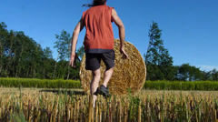 Country-side fitness, man doing exercises on haybale Stock Footage