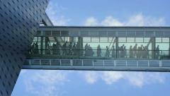 People walking through hallway. group team business company. glass building Stock Footage
