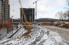 Cranes and building construction Stock Photos