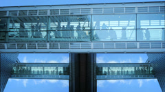 modern futuristic glass hallway tower. group team together. business people - stock footage