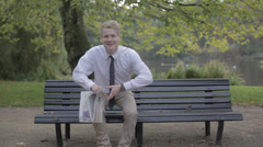 Man With Newspaper In The Park Stock Footage