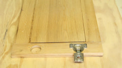 Carpenter installing cabinet hinges Stock Footage