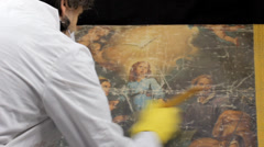 art conservation, Cleaning a Painting - stock footage