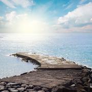 stone pier at sunny day - stock photo
