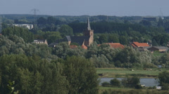 View from push moraine hill Grebbeberg at village zoom out + pan River Rhine Stock Footage