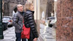Middle Aged Married Couple Window Shopping In Prague Stock Footage
