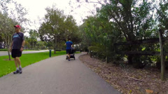 Stock Video Footage of Man running with a stroller