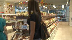 Candy shop. People buy goods Stock Footage