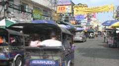 A Tuktuk Races Along Khaosan Road  Stock Footage