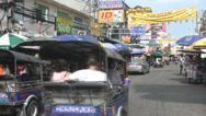 Stock Video Footage of A Tuktuk Races Along Khaosan Road
