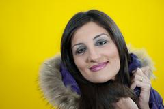 young woman with yellow background  - stock photo