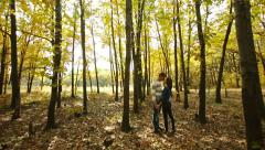 Couple in Autumn Forest Stock Footage