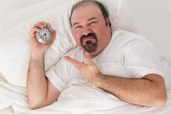Man kept awake by noisy neighbours Stock Photos