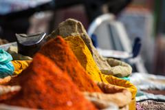 Stock Photo of indian colored spices at local market.