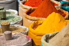 indian colored spices at local market. - stock photo