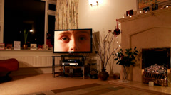 Child's sad eyes on television at Christmas (model release) Stock Footage