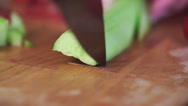 Stock Video Footage of Female hands with knife, cutting fresh cucumber