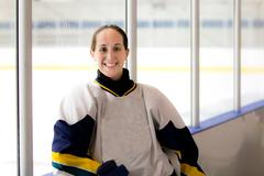 Female ice hockey player after a game - stock photo