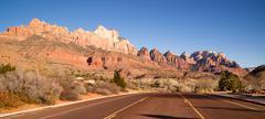 Two lane road highway travels desert southwest utah landscape Stock Photos