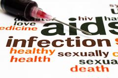 syringe and aids infection - stock photo