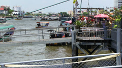 Boats and pontoon in Bangkok Thailand Stock Footage