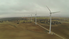 Wind turbines on a moody day - stock footage