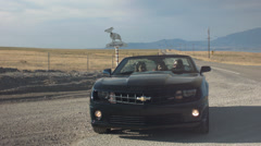 Teen Girls In A Convertible, Pulled Over At A Remote Desert Turnoff Stock Footage