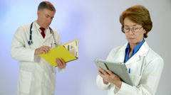 Paper or tablet pc doctors review data Stock Footage