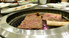 KOREAN BBQ COOKED IN A  NON STICK TABLE TOP HOT PAN (BBQ--1b) Stock Footage
