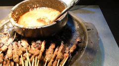 SATAY STICKS WITH CHICKEN, MUTTON MEAT AND SAUCE. (SATAY--1A) Stock Footage