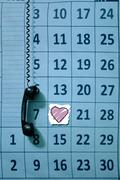Stock Photo of calender page with a detail of the valentine day, telephone receiver, concept
