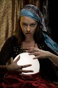 fortune teller psychic gypsy at crystal ball - stock photo