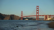 Stock Video Footage of Golden Gate Bridge Day with Calm Waves on Beach
