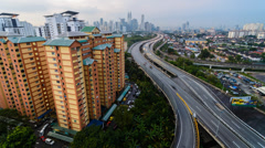 Timelapse Cloudy Sunset KL Cityscape From Berembang 4K Stock Footage