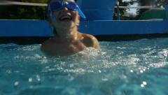 Boy jumping and diving in Swimming Pool. Kids. Slow Motion Stock Footage