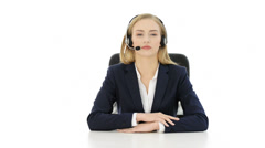 Tired, young beautiful business woman sitting at call center. Stock Footage