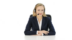 young business woman at call center is looking aside. - stock footage