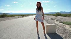 sexy leg hitchhiker desert highway - stock footage