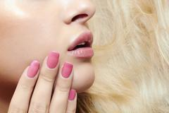 Stock Photo of lips,nails and hair of beautiful blond woman
